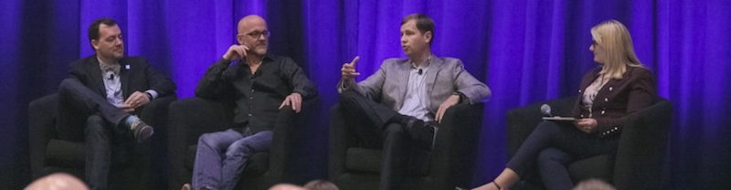 4 people speaking on a panel