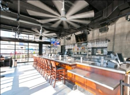 Garage doors surround the four season patio, which also features large stainless