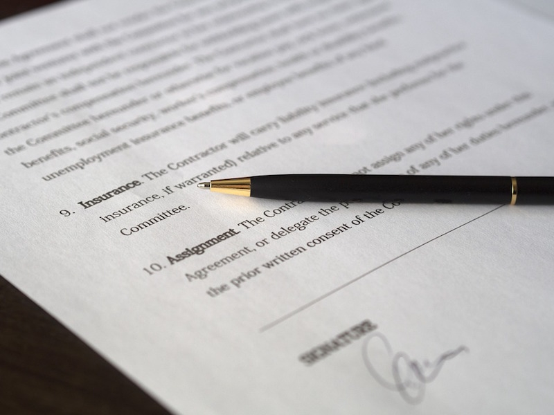 A pen sitting on top of a contract