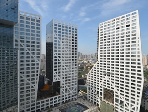 Sliced Porosity Block combines concrete and glass towers with public plazas.