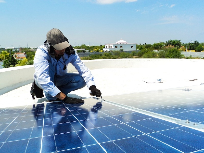 Solar panel being installed