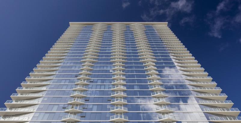 A high-rise hotel shot from below