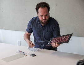 Dane Stokes, a Design Technology Specialist with ZGF Architects, shown with floor sensors, AEC Innovators, BD+C