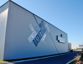 Two separate metal gym buildings accommodate a total of four full-size basketbal