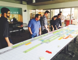 A project team in Skanska's Seattle office works with design partners in a Lean pull planning session for a development in downtown Seattle.