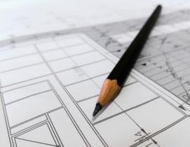 A pencil and blueprint