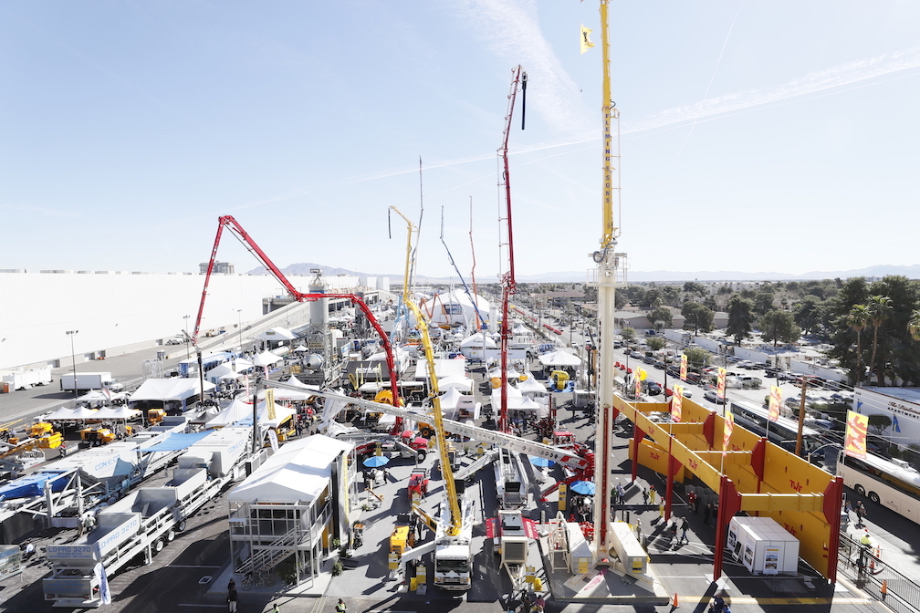 Cranes against a blue sky on day one of Conexpo.