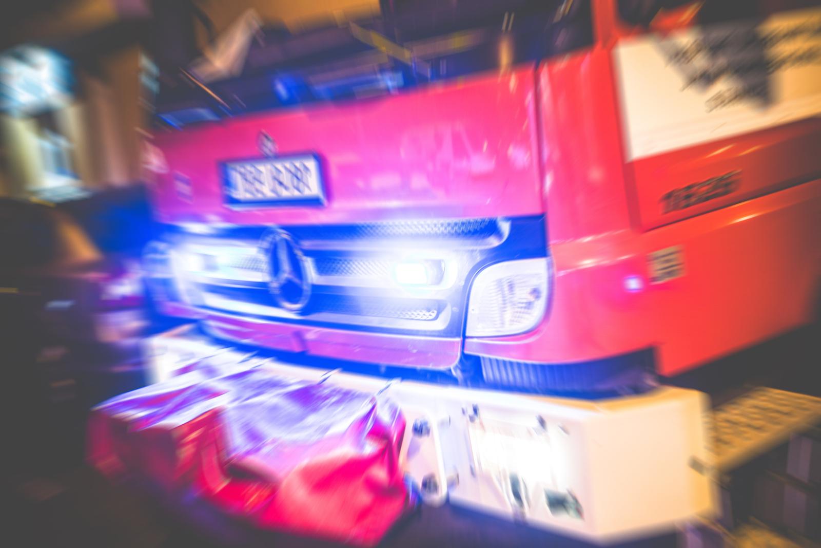 Ambulance illuminated in the dark of night.