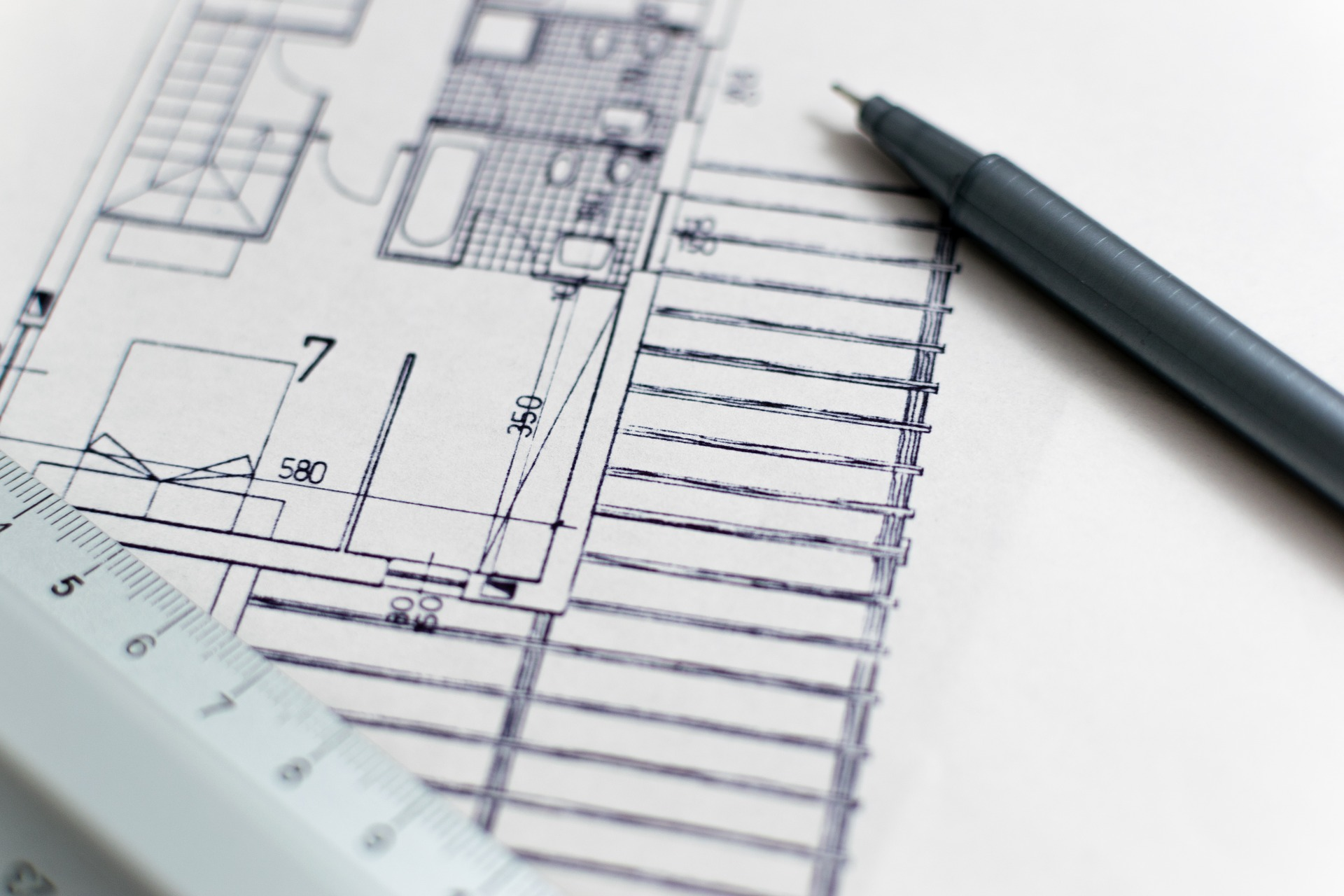 Blueprint of a home drawn on a white sheet of paper.