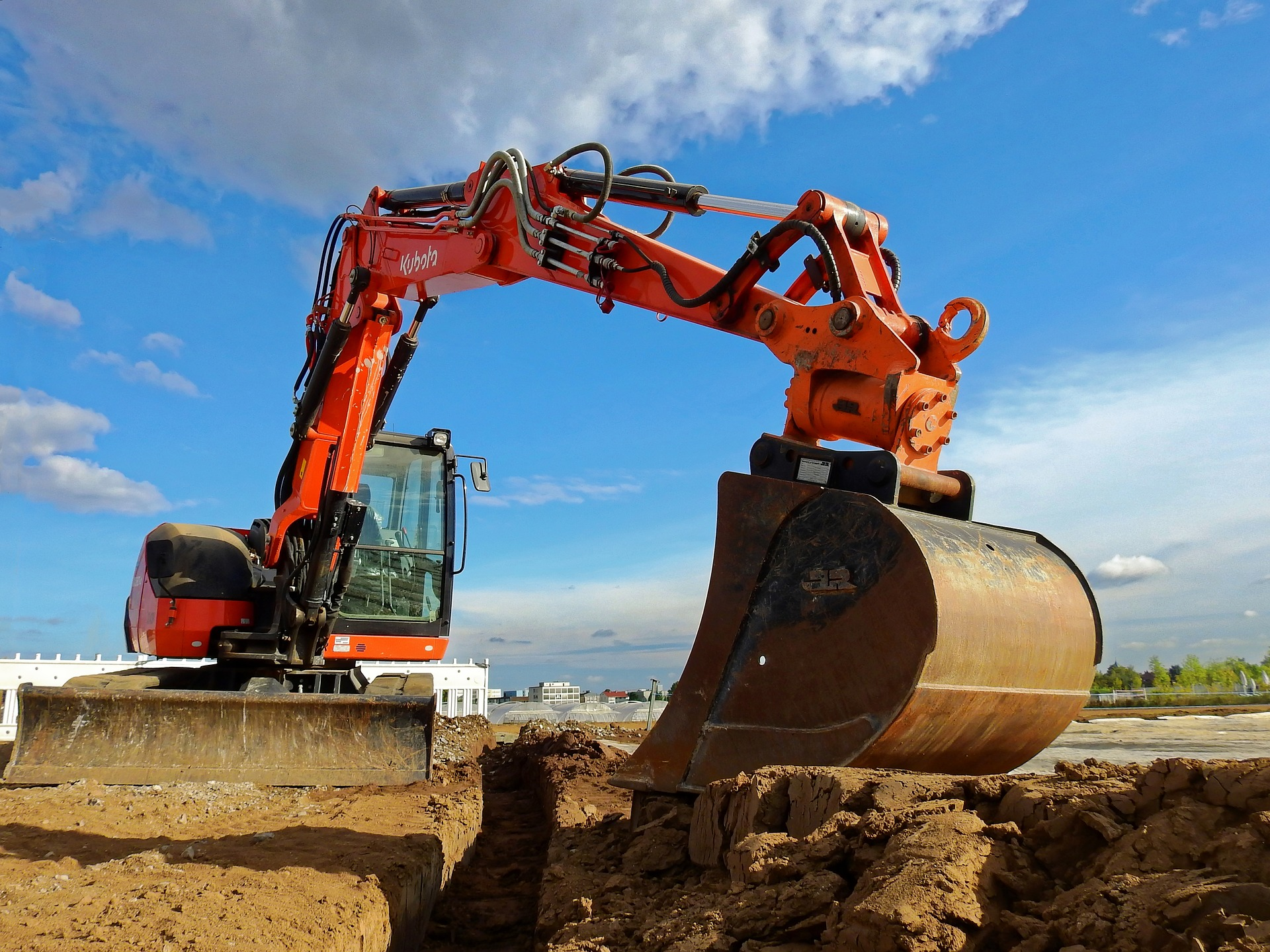 Excavator digging on a construction site.