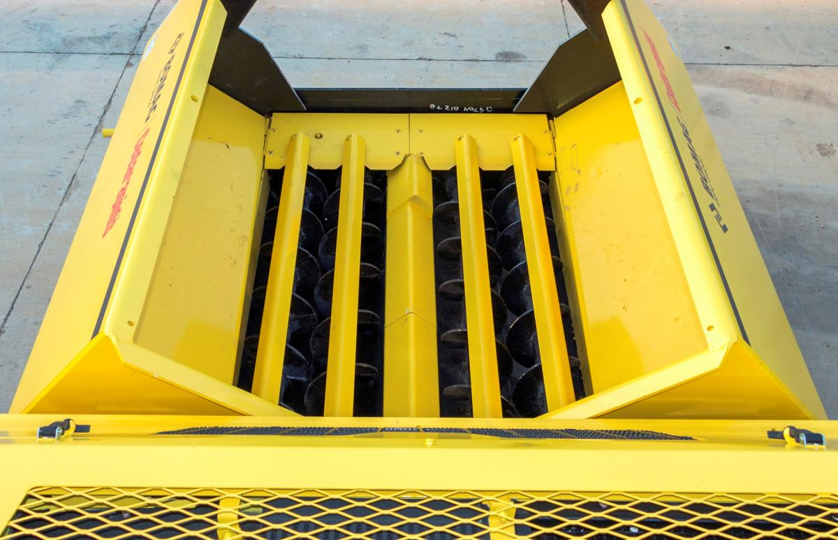 BOMAG Remix Anti-Segregation System uses in-hopper augers to help promote both material and temperature uniformity in the mix.