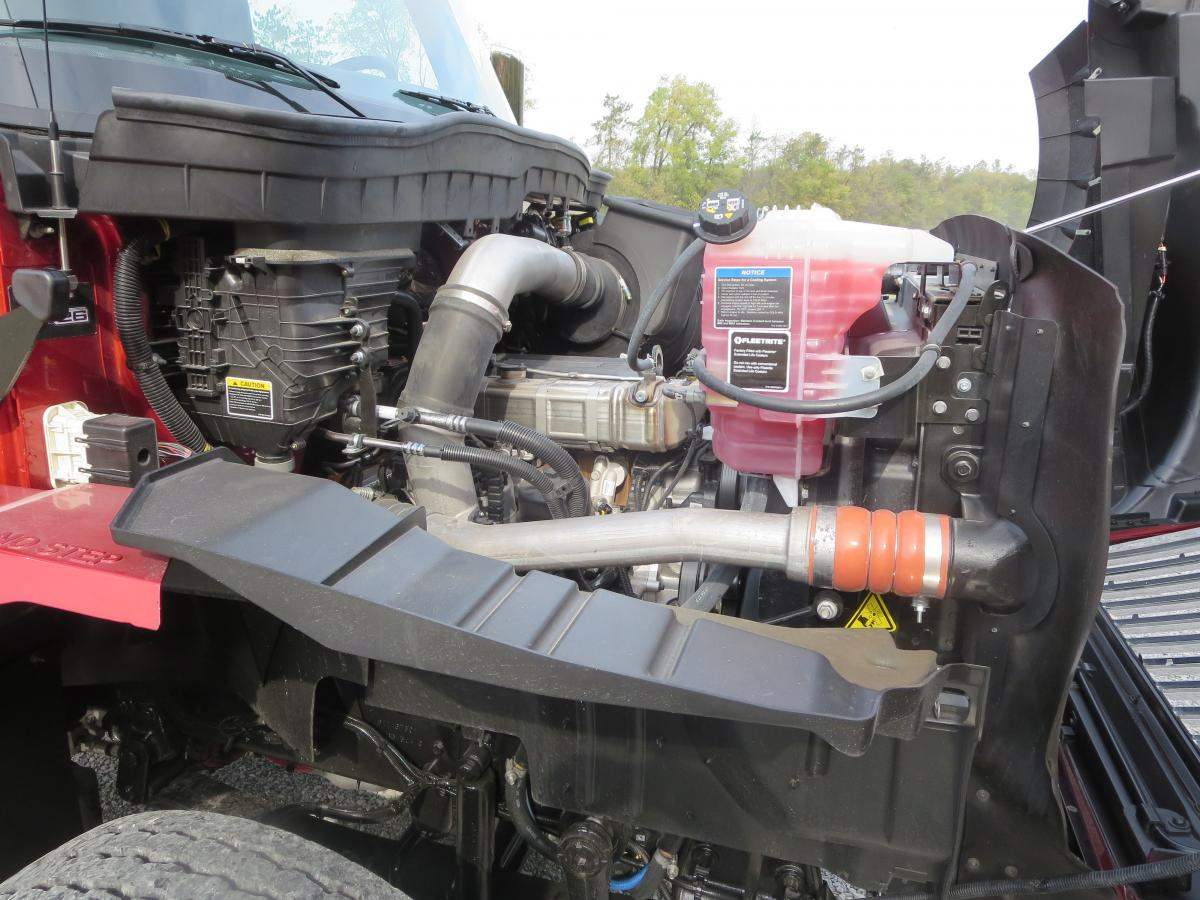 Navistar's 12.4-liter A26 nestles in the big engine compartment