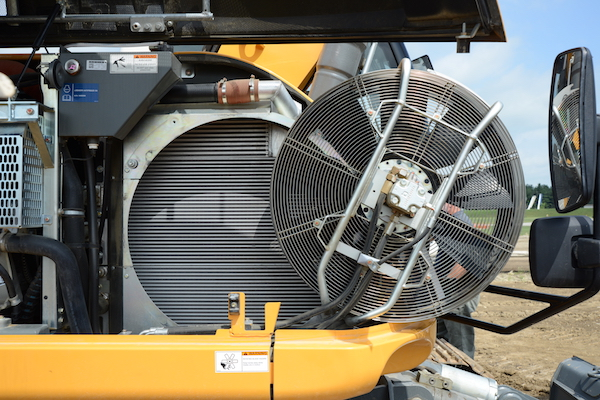 Reversible fan that swings out for cooler cleaning