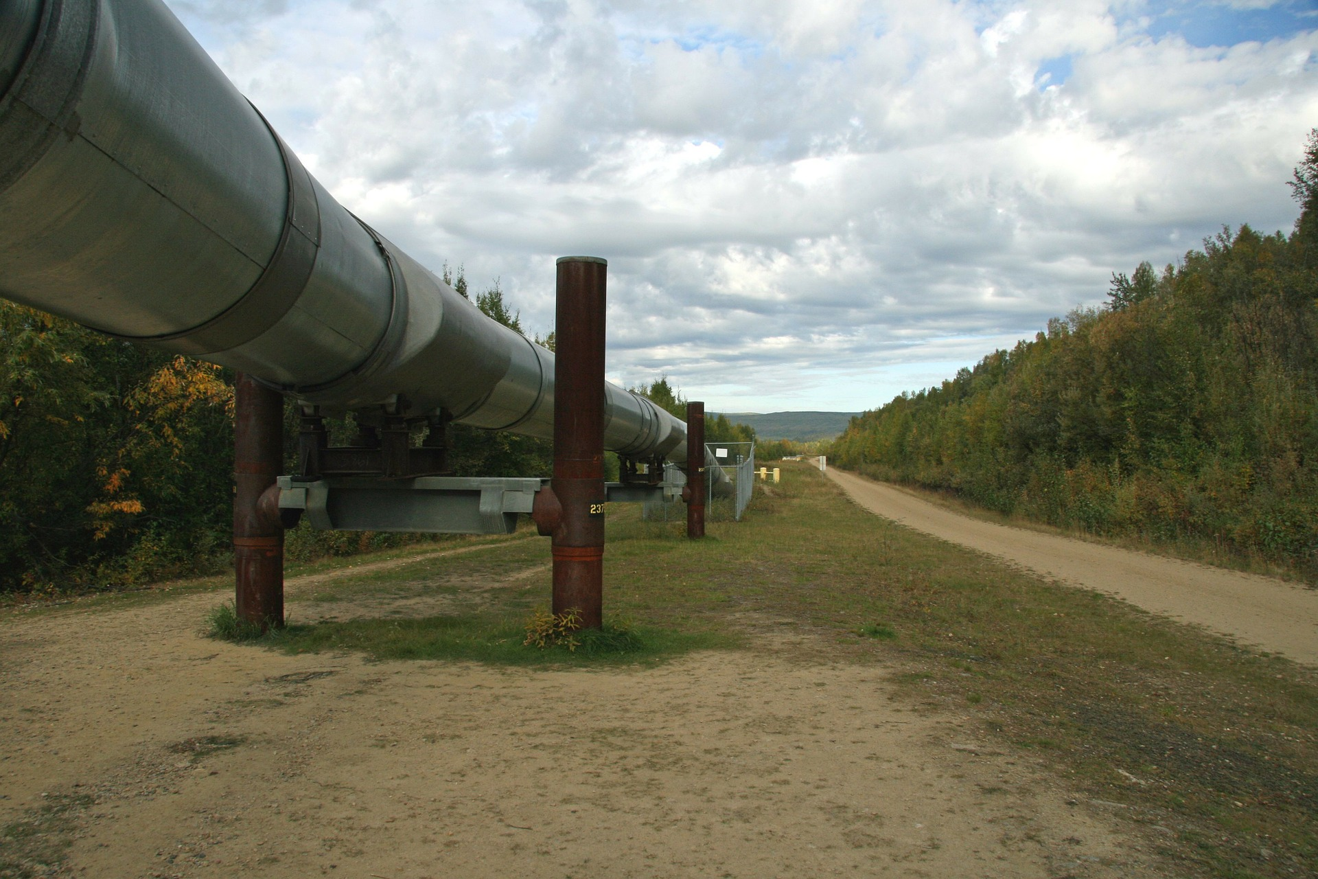 A pipeline running through fields of land.