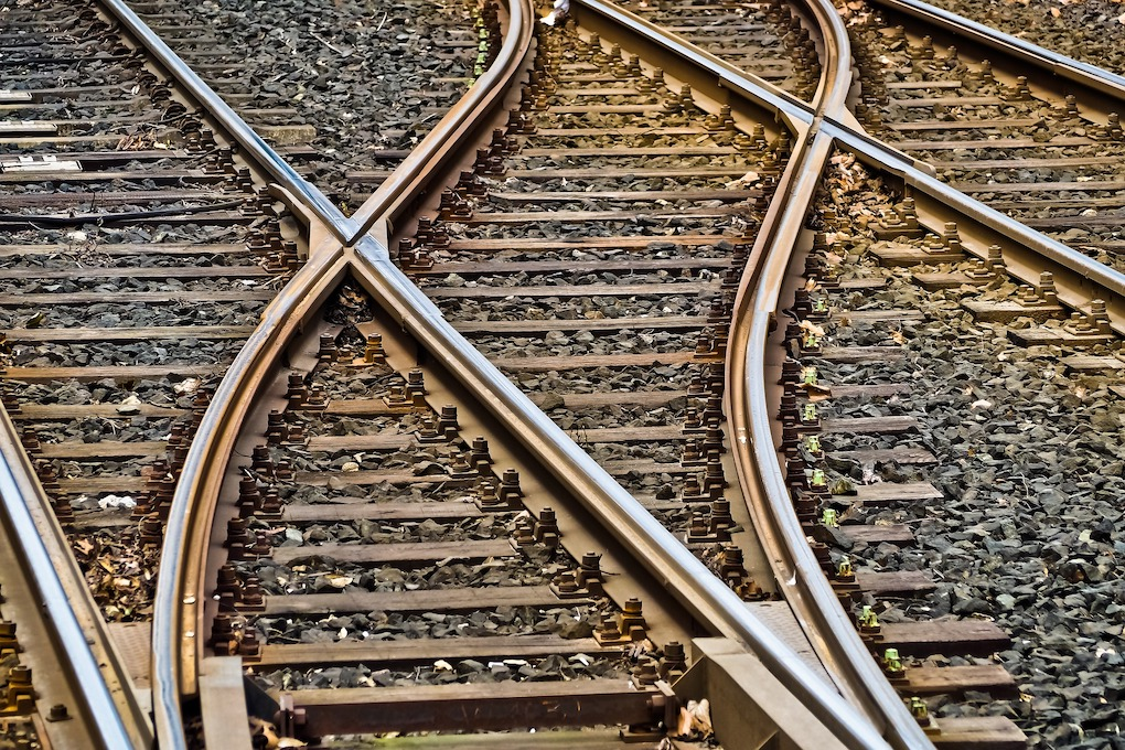 Railroad tracks overlapping each other.