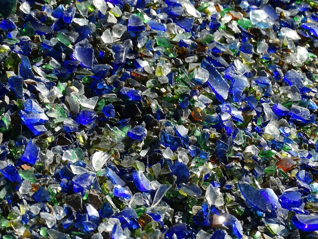 Shards of various colorful glass in a wide pile.