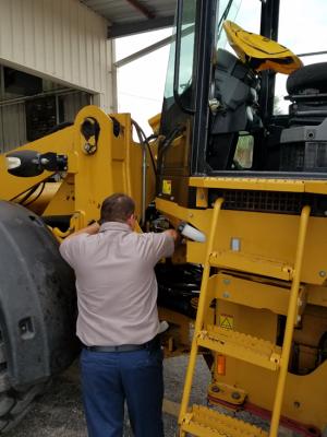 A technician finalizes maintenance checks.