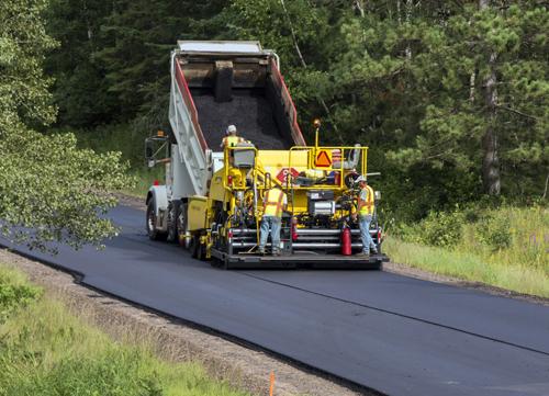 Cedarapids paving a two lane asphalt road
