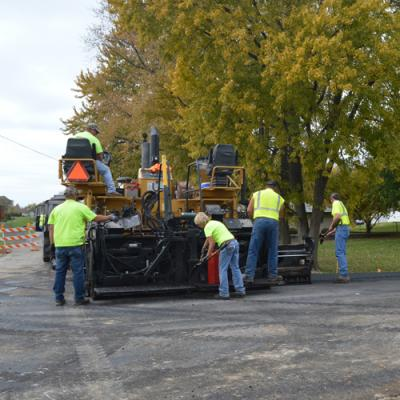 Workers lay asphalt on a local road in Quincy, Illinois.