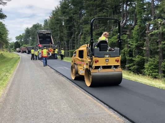 Maymead's all-women's paving crew laying asphalt on a project.