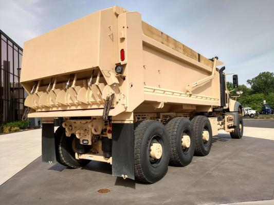 Army M917A3 tail gate can be opened for normal dumping, or the driver can remotely open any of four chutes for furrow placement of aggregates.