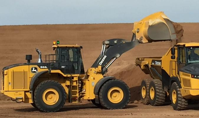 844L wheel loader dumps into an articulated truck