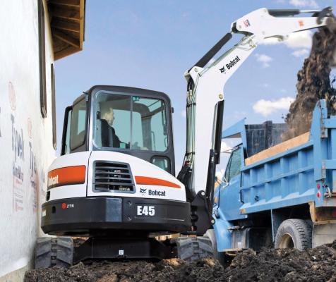 Bobcat E45 mini excavator loads a truck