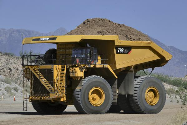 Caterpillar is expanding its mining truck line with two electric-drive models, the 798 AC and 796 AC.