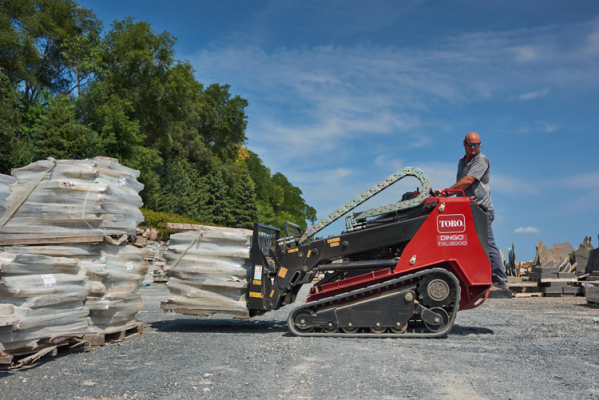 The TXL 2000 compact utility loader has telescoping arms
