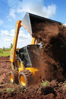 Gehl V420 skid steer loader weighs 11,665 pounds and has a rated operating capacity of 4,200 pounds.