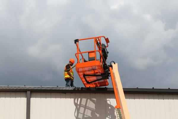 A Bolt-On Fall Arrest System can be bolted to existing JLG platforms in the field.