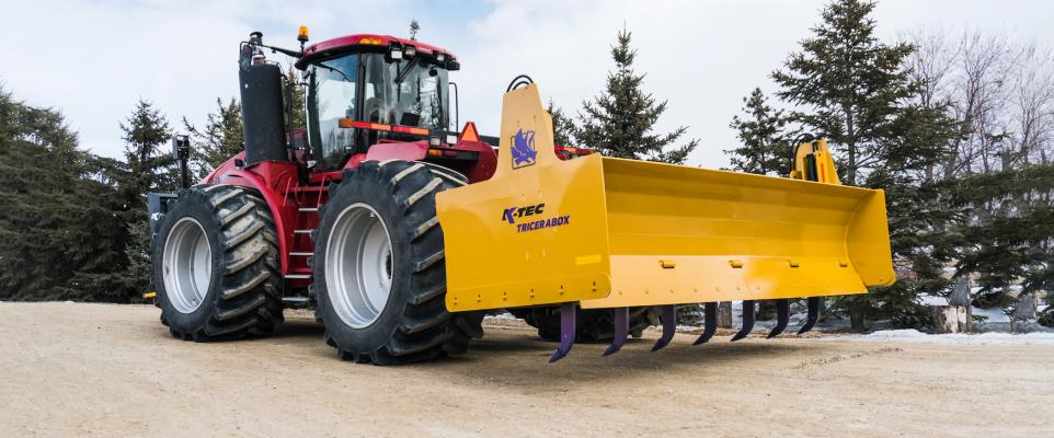 The K-Tec Tricerabox is a 14-foot-wide box blade that is mounted to the 3-point hitch on the rear of tractors 500 horsepower and above.