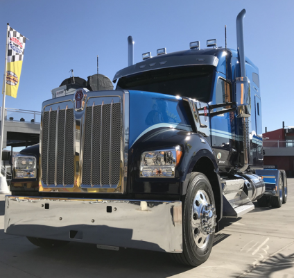 Kenworth W990 touts a wide cab; up-to-date interior; and a long, sculpted hood