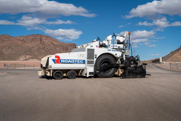Roadtec RP-250e asphalt paver is a 10-foot tracked unit powered by a Cummins diesel
