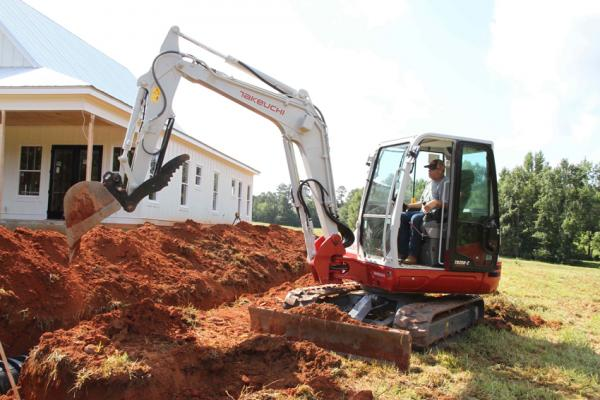 Takeuchi TB250-2 compact excavator has an operating weight of 10,957 pounds