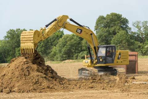 Cat 333 excavator working on a trench.