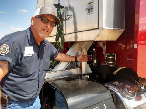 Truck driver points to the Cabmate ROI system.