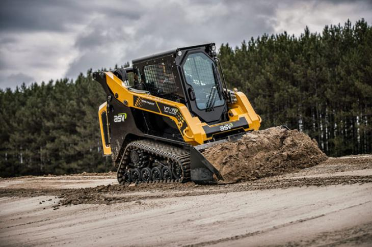 Compact track loader carries dirt in its bucket