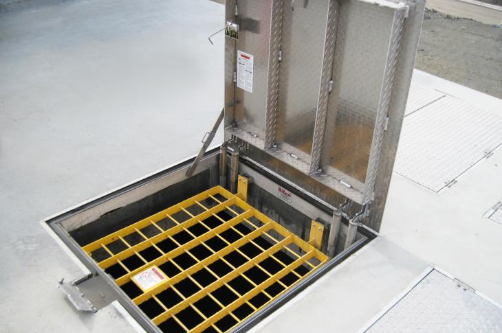 Fall Protection Grating for floor access doors allows workers to inspect pumps and monitor underground areas.