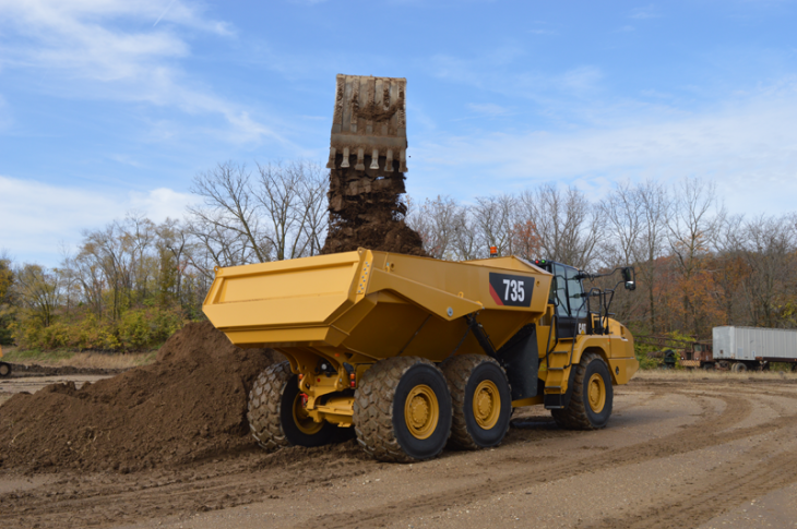 Cat 735 being loaded by an excavator