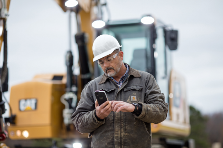 Cat App displays location, operating hours, machine health, and utilization data.