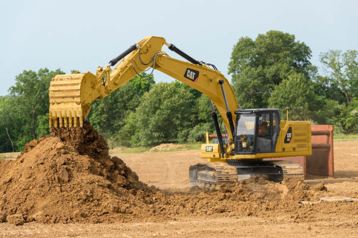 Cat 330 excavator has an operating weight of 68,125