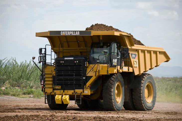 Cat 777G off highway truck carries 98.4 tons with a volume of 83.8 cubic yards.