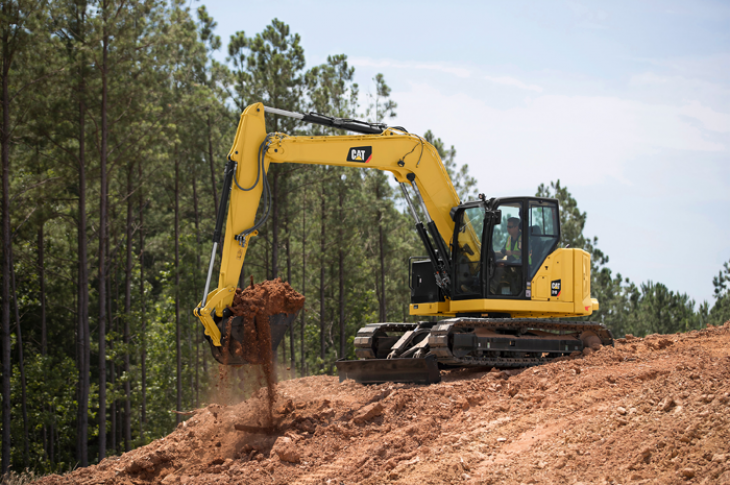 Cat 310 excavator has an operating weight of 22,447 pounds