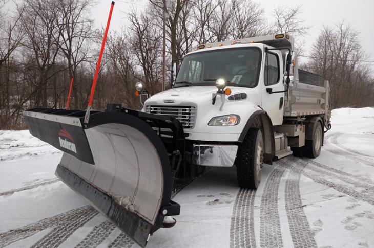 Freightliner plow truck sports a 10 foot steel blade on its Henderson plow mount