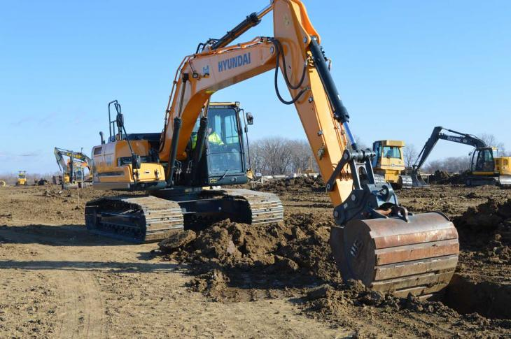 Hyundai HX220L excavator digs in frozen ground