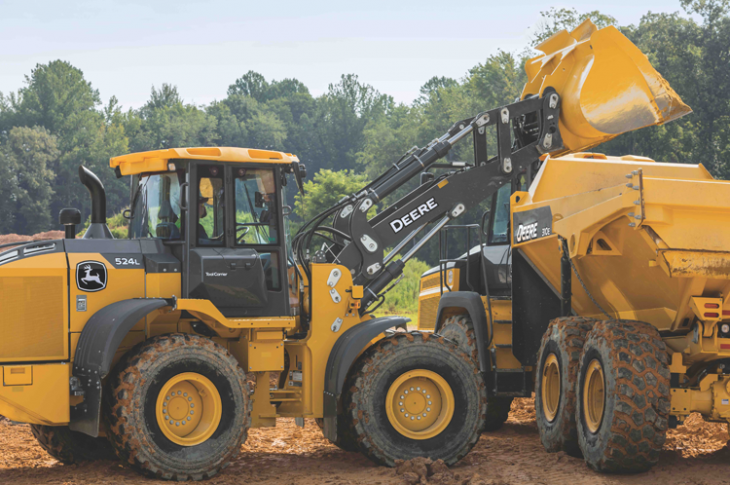 John Deere 524L wheel loader with a truck