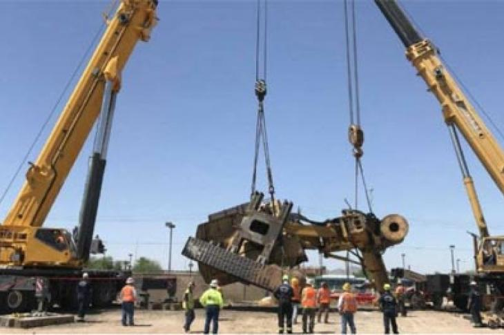 Two cranes were required to move a drill rig at the Phoenix airport.