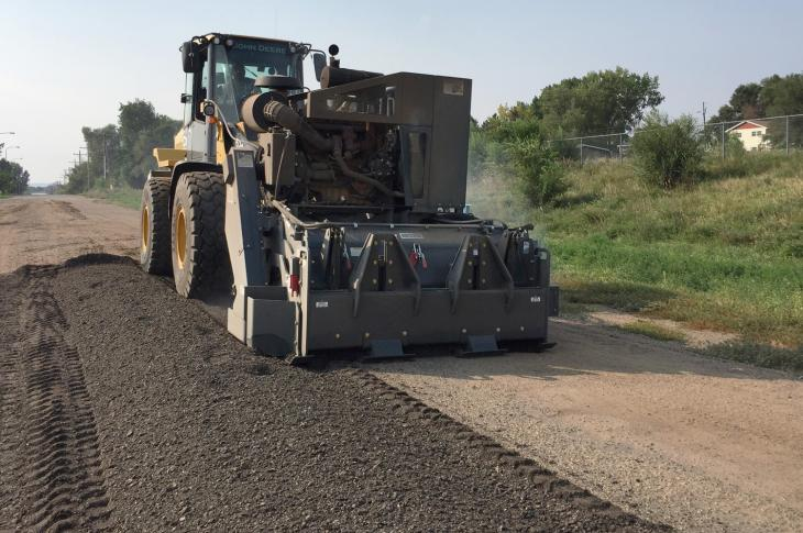 Milling/stabilizing attachments for wheel loaders mill asphalt prior to overlay, cut utility trenches, and perform in-place recycling of chip and seal as well as stabilization of road base and soil.