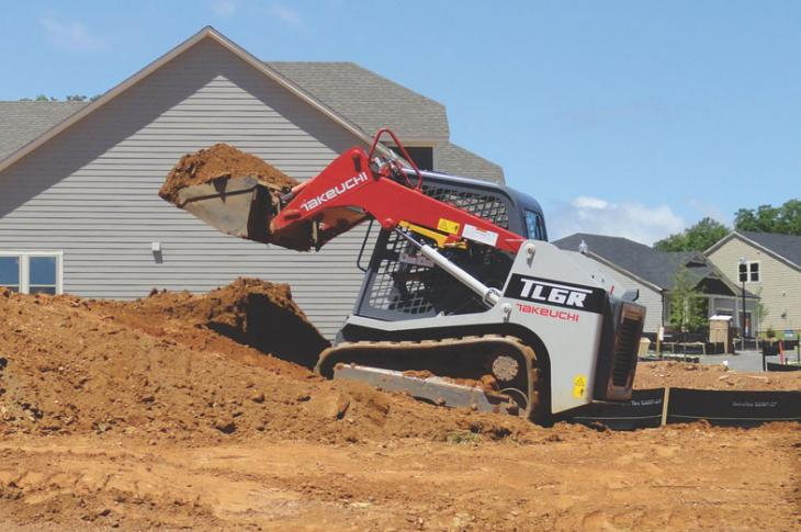 Takeuchi TL6R moves dirt at a housing development.